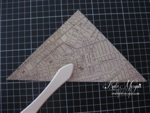 Step-by-Step Fold paper in half diagonally.